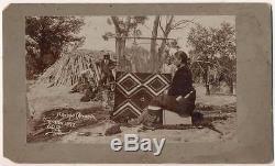 1897 NATIVE AMERICAN INDIAN WOMAN NAVAJO WEAVER AT BLANKET LOOM, POTTERY, HOGAN